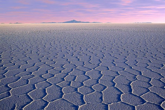 close up of Uyuni Salt Flats with pink and purple sky