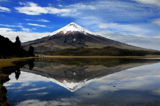 Cotopaxi with its reflection from a lake in front of it