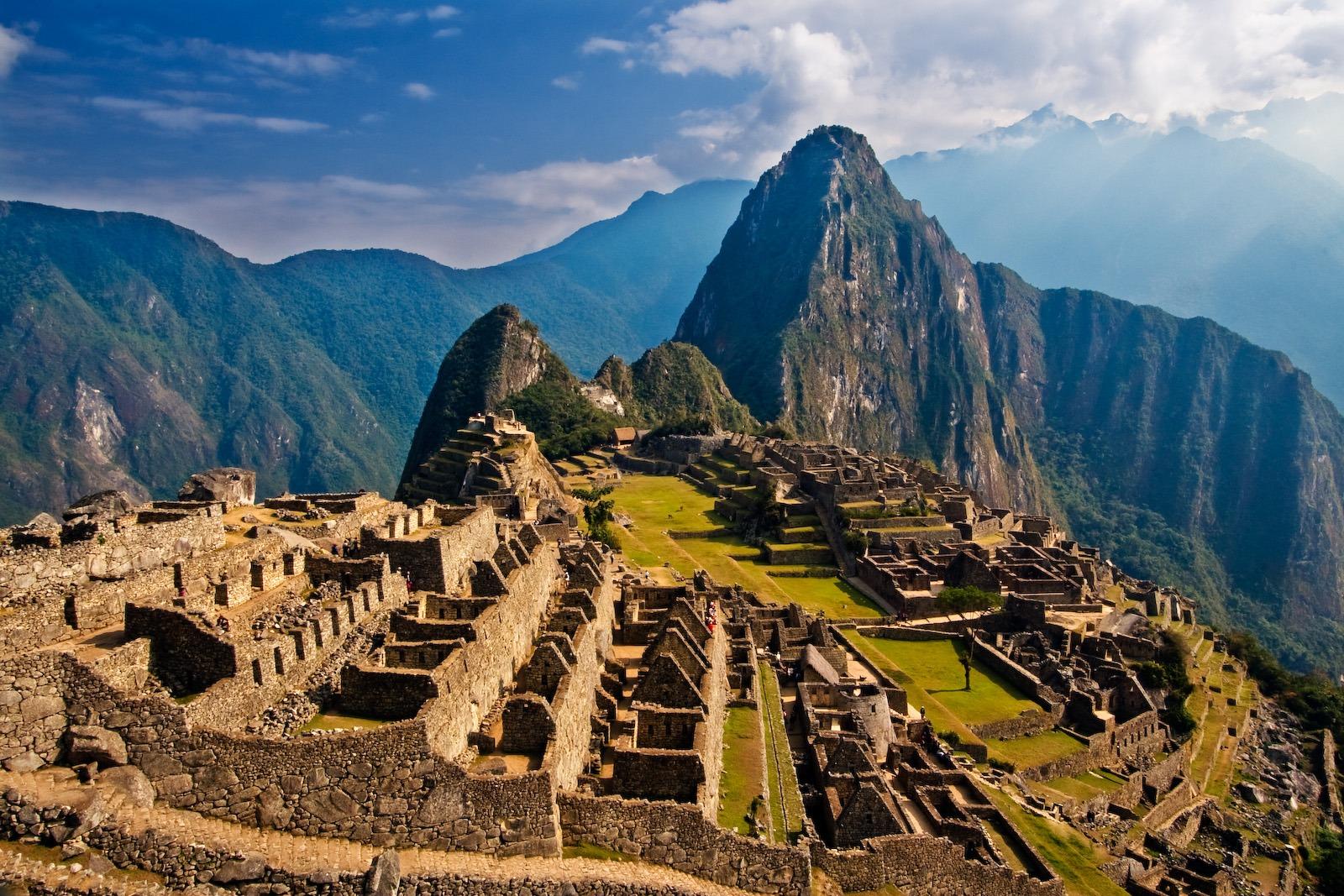 view of the ruins of Machu Picchu with Huayna Pichu Peru in the distance Peru