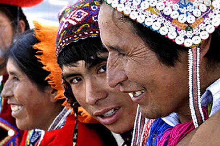 Andean people talk and smiling with chullos and native clothing
