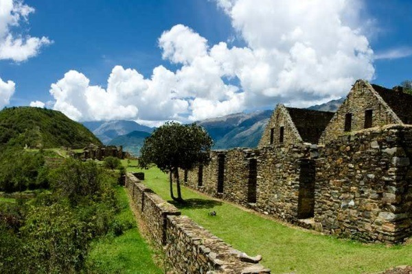 beautiful view of a section choquequirao with andes mountains in the distance.
