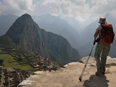 A hiker finishing the Inca Trail in South America on a Southern Crossings vacation.
